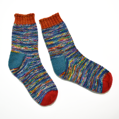 Hand knitted socks by Janet Rice-Bredin using Erica Lueder's Hermione's Everyday Sock stitch pattern and Hedgehog Fibre Sock Kimono