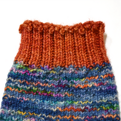 Hand knitted sock orange ribbed cuff using Jeny's Surprisingly Stretchy Bind Off