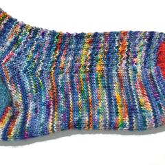 Hand knitted sock using Hedgehog Fibre Sock yarn in the Kimono colourway.