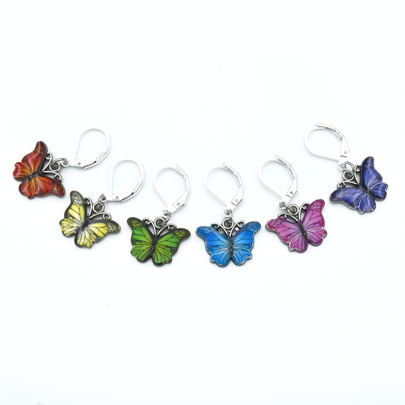 Set of six enamel butterfly charm crochet locking stitch markers in red, yellow, green, blue, pink and purple for crochet by Pretty Warm Designs