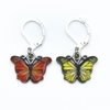 Two enamel butterfly charm crochet locking stitch markers in red and yellow for crochet by Pretty Warm Designs
