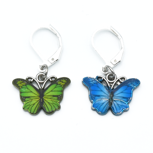 Two enamel butterfly charm crochet locking stitch markers in green and blue for crochet by Pretty Warm Designs