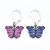 Two enamel butterfly charm crochet locking stitch markers in pink and purple for crochet by Pretty Warm Designs