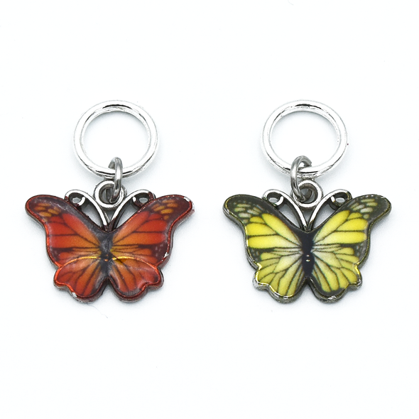 Two enamel butterfly charm snag free ring stitch markers in red and yellow for knitting by Pretty Warm Designs