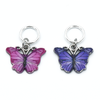 Two enamel butterfly charm snag free ring stitch markers in pink and purple for knitting by Pretty Warm Designs