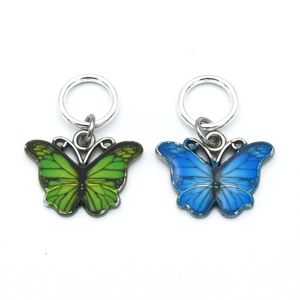 Two enamel butterfly charm snag free ring stitch markers in green and blue for knitting by Pretty Warm Designs