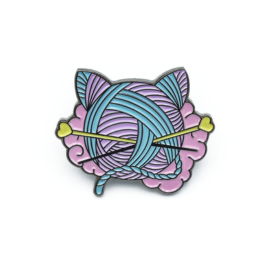 Pink, turquoise and yellow enamel on black background cat shaped yarn knitting pin by Pretty Warm Designs