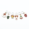 Set of six enamel Christmas themed charms snag free ring stitch markers for knitting by Pretty Warm Designs