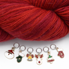 Set of six enamel Christmas themed charms snag free ring stitch markers with yarn for knitting by Pretty Warm Designs