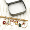 Set of six enamel Christmas themed charms snag free ring stitch markers on needle with tin for knitting by Pretty Warm Designs