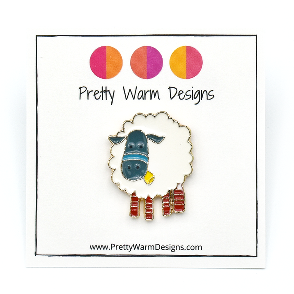 White, teal, yellow and red enamel on gold toned metal sheep pin by Pretty Warm Designs