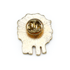 Back of white, teal, yellow and red enamel on gold toned metal sheep pin by Pretty Warm Designs