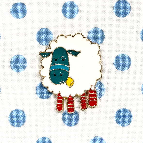White, teal, yellow and red enamel on gold toned metal sheep pin on blue polka dot fabric project bag by Pretty Warm Designs