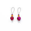 Two fuchsia pink glass crackle beads, orange Austrian crystals, purple seed beads and nylon coated snag free wire stitch markers for knitting by Pretty Warm Designs