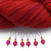 Set of six fuchsia pink glass crackle beads, orange Austrian crystals, purple seed beads and nylon coated snag free wire stitch markers with yarn for knitting by Pretty Warm Designs