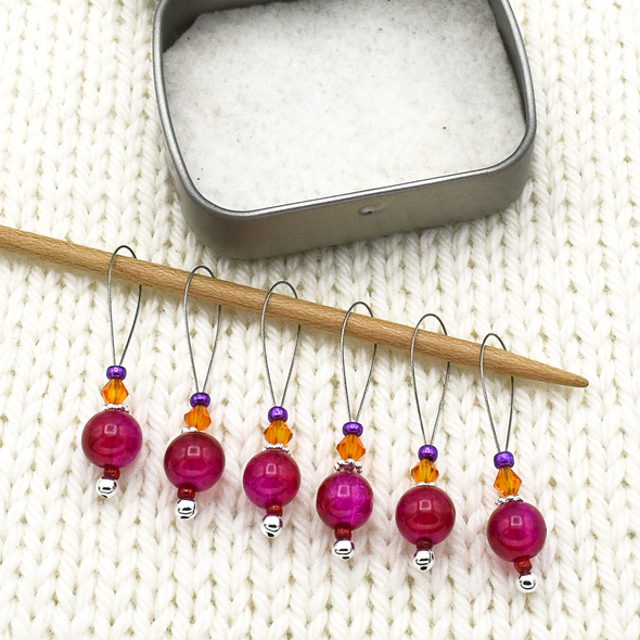 Set of six fuchsia pink glass crackle beads, orange Austrian crystals, purple seed beads and nylon coated snag free wire stitch markers with tin on needle for knitting by Pretty Warm Designs