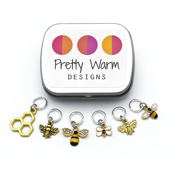Set of six gold toned bee themed charms snag free ring stitch markers and tin for knitting by Pretty Warm Designs