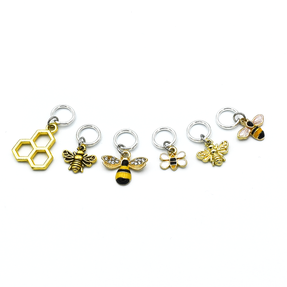 Set of six gold toned bee themed charms snag free ring stitch markers for knitting by Pretty Warm Designs