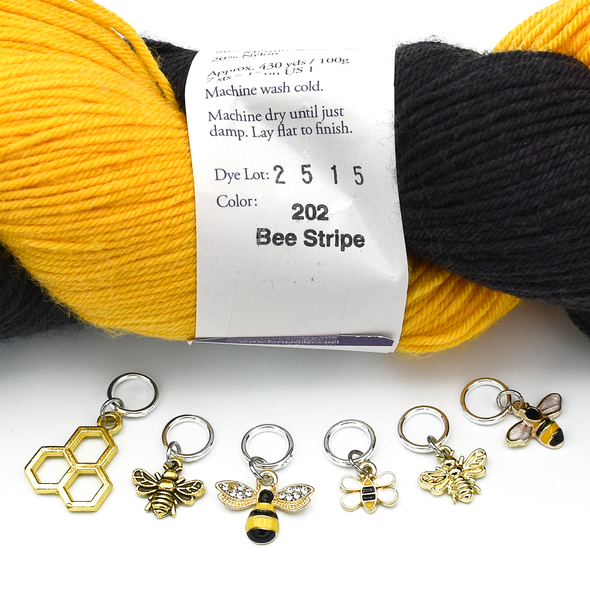 Set of six gold toned bee themed charms snag free ring stitch markers with yarn for knitting by Pretty Warm Designs