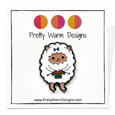 White and multicoloured enamel on black background sweater knitting sheep brooch pin by Pretty Warm Designs