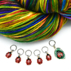 Set of five red and black enamel ladybug and one red, black and green ladybug on a leaf charms snag free ring stitch markers with a varietgated skein of yarn for knitting by Pretty Warm Designs