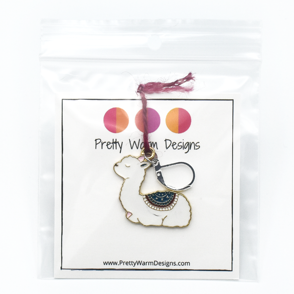 White, pink, teal and dark red enamel on gold toned background with silver plated lever back clasp crochet locking stitch marker attached by yarn to cardstock with logo and text in plastic zip bag by Pretty Warm Designs