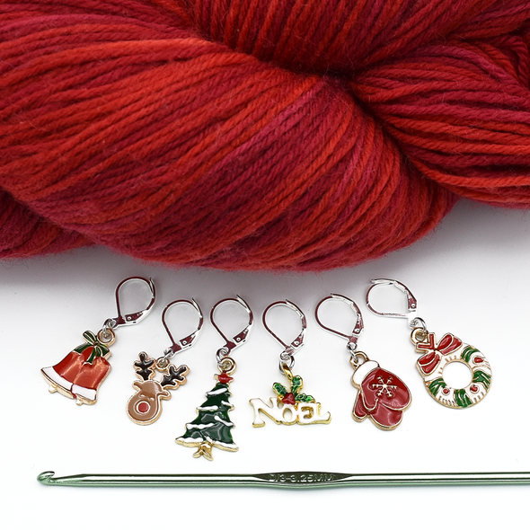 Set of six different Christmas themed charms locking stitch holders with hook and yarn for crochet and knitting by Pretty Warm Designs