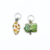 Two multi coloured enamel leaf and tree charms snag free ring stitch markers for knitting by Pretty Warm Designs