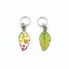 Two multi coloured enamel leaf charms snag free ring stitch markers for knitting by Pretty Warm Designs
