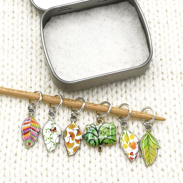 Set of six multi coloured enamel leaf and tree charms snag free ring stitch markers on needle with tin for knitting by Pretty Warm Designs