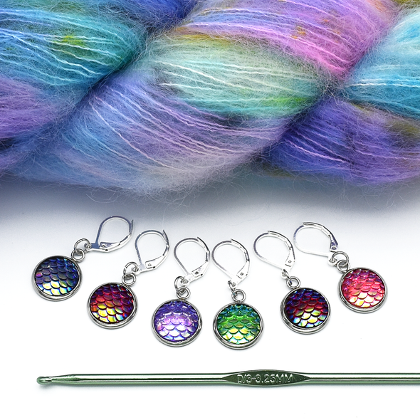 Set of six iridescent mermaid scale locking stitch markers with yarn and hook for crochet by Pretty Warm Designs