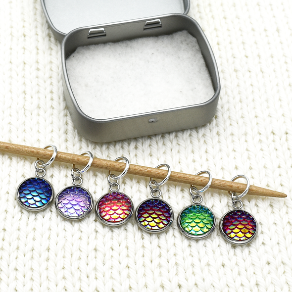 Set of six iridescent mermaid scales snag free ring stitch markers with tin on needle for knitting by Pretty Warm Designs