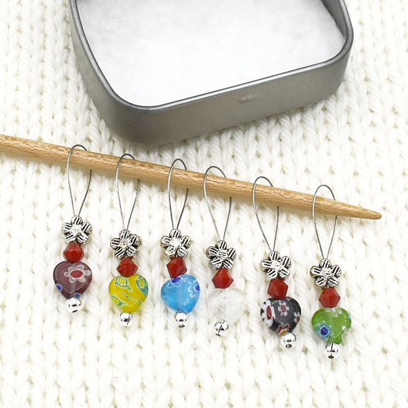 Set of six multi coloured glass heart beads, red crystal beads and antiqued silver flower beads stitch markers for knitting with decorative tin by Pretty Warm Designs