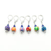Set of six multi coloured flower beads, blue crystal beads, seed beads and silver plated lever back clasps stitch markers for crochet by Pretty Warm Designs