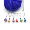 Set of six multi coloured flower beads, blue crystal beads, seed beads and silver plated lever back clasps stitch markers with hook and yarn for crochet by Pretty Warm Designs