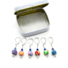 Set of six multi coloured flower beads, blue crystal beads, seed beads and silver plated lever back clasps stitch markers with tin for crochet by Pretty Warm Designs