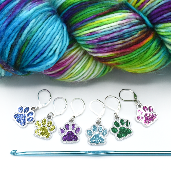 Set of six blue, light green, purple, turquoise, dark green and pink paw print pet charms on silver plated lever back clasps stitch holders with hook and yarn for crochet by Pretty Warm Designs