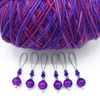 Set of six purple crackle glass beads, silver barrel beads, blue bicone crystal beads and purple seed beads on nylon coated wire, snag free stitch markers with yarn for knitting by Pretty Warm Designs