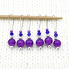 Set of six purple crackle glass beads, silver barrel beads, blue bicone crystal beads and purple seed beads on nylon coated wire, snag free stitch markers on needle for knitting by Pretty Warm Designs
