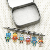 Set of six multi coloured enamel robot charms snag free ring stitch markers with tin on needle for knitting by Pretty Warm Designs