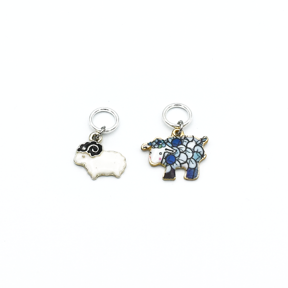 Two enamel sheep charm snag free ring stitch markers for knitting by Pretty Warm Designs