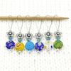 Set of six Millefiori flat glass circle beads, turquoise Austrian crystal beads, silver flower beads stitch markers on wire with needle for knitting by Pretty Warm Designs