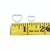 Large and small heart ring knitting stitch markers above measuring tape by Pretty Warm Designs