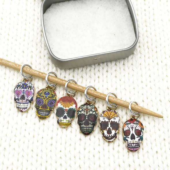 Set of six enamel sugar skull charms snag free ring stitch markers on knitting needle with tin by Pretty Warm Designs