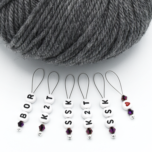 Set of six acrylic beads with BOR, K2T, SSK and red heart, deep purple Austrian crystal beads and wire snag free stitch markers with grey yarn for sweater knitting by Pretty Warm Designs