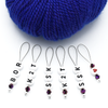 Set of six acrylic beads with BOR, K2T, SSK and red heart, deep purple Austrian crystal beads and wire snag free stitch markers with blue yarn for sweater knitting by Pretty Warm Designs