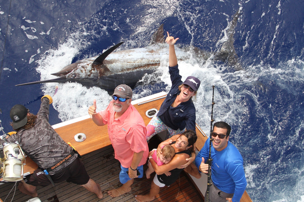Dana Susina and her famliy with her 550 pound blue marlin tag and release