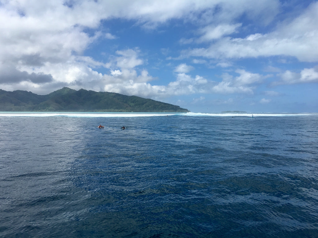 Christa and Tina floating back from mini teahupoo