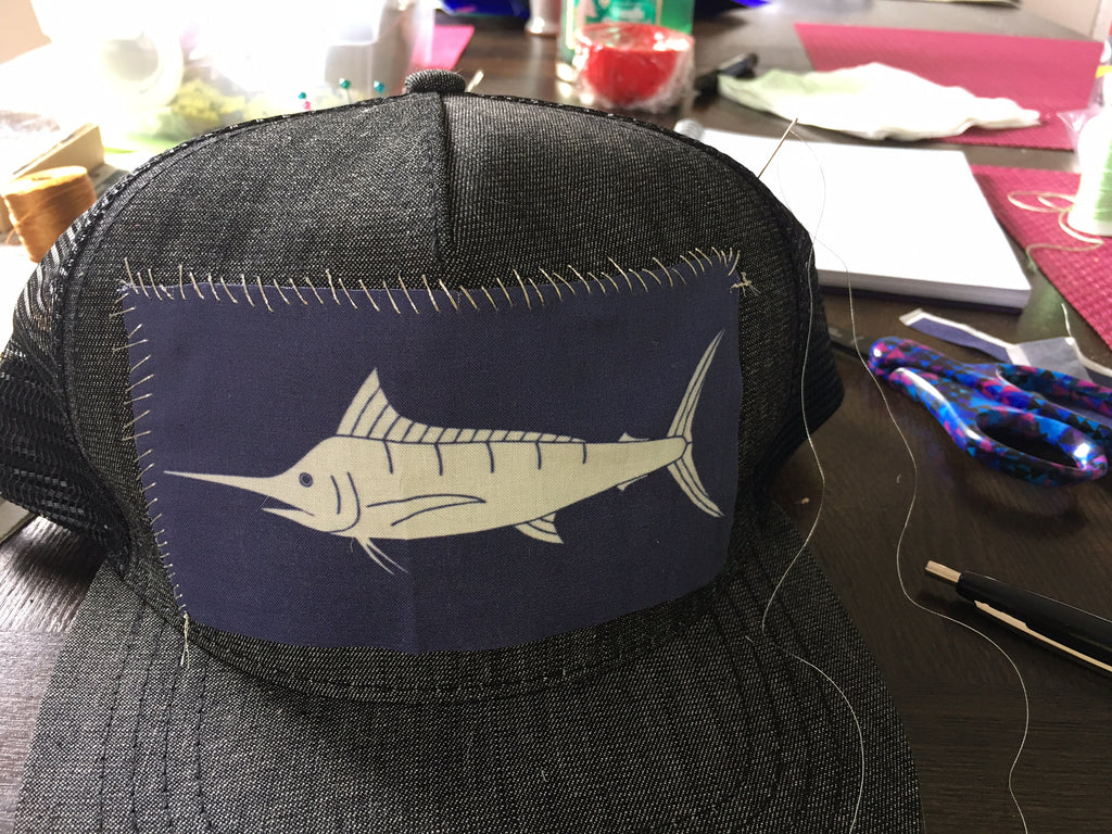 Sundot Marine Marlin patch hat sample being sewn
