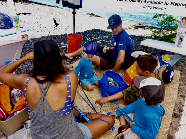 sundot marine helping make mobile recycled trash art with the kids in puako